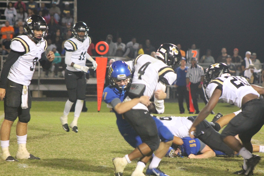(Photo by Adam Routon) Jeremiah Guenther making a tackle Friday night.