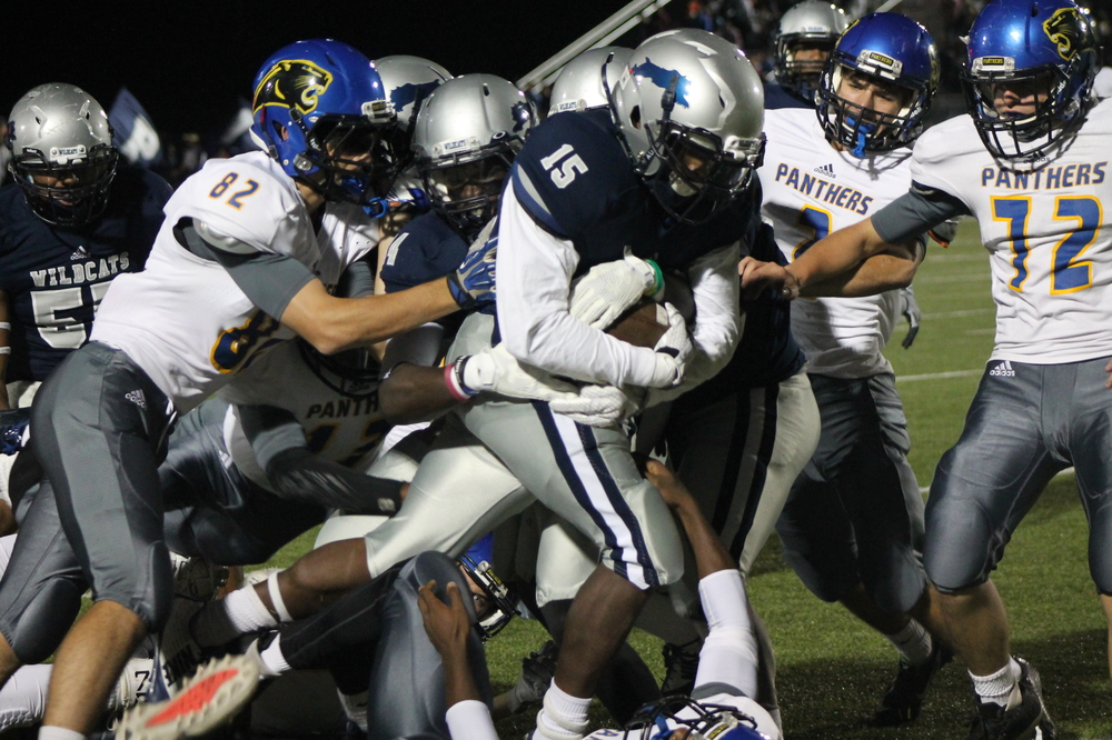 (Photo by Maddy Routon) North Lamar defense trying to bring down T.D. Williams of Paris High.