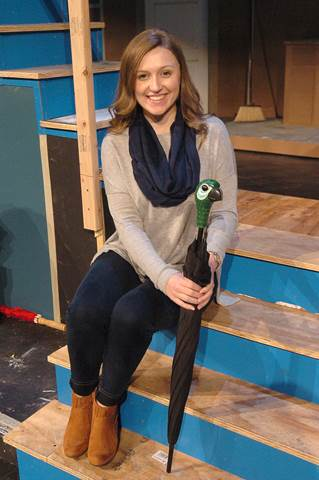 Brittany Birch, who stars as Mary Poppins' in North Lamar's upcoming play, holds Mary's parrot umbrella that will be given away during the Theatre Department's 'A-Toy-A-Ticket' toy drive benefitting Toys for Tots.