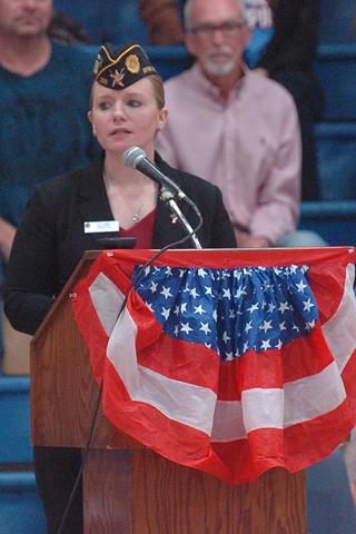 Leah Bates Morales addresses an audience of veterans, guests and students at North Lamar High School's annual Veterans Day program.