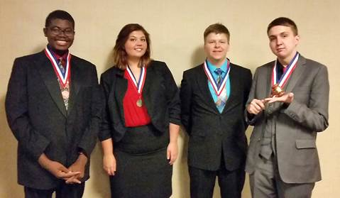Pleased with their results at the UIL Region Student Congress competition from North Lamar High School, beginning left, are Jordan Walters (3rd place), Kay Edwards (1st place), Jake Chollet (5th place), and Steele Musgrove (2nd place and Top Presiding Officer).