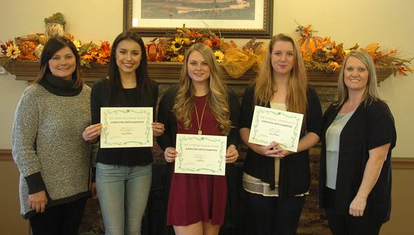 Lamar Place Assisted Living recognized the top winners of the First Annual Juried Fine Arts Exhibition.  From left are Community Relations Manager Laura Spencer, North Lamar High School students Sarah Mijares, Taylor Kyle, and Lauren Arnold, and Executive Director Cortney Dawes.  Not pictured is art student Gracie Mullens.