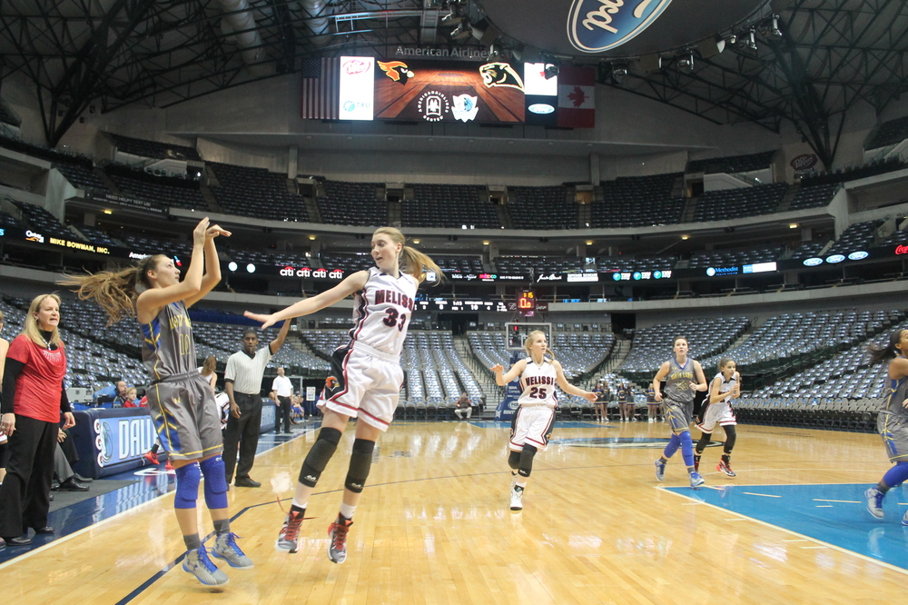 (Photo by Amanda Posey) Madison Morrison with a jump shot against Melissa