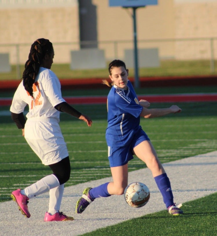 Sadi English from JV controlling the ball.