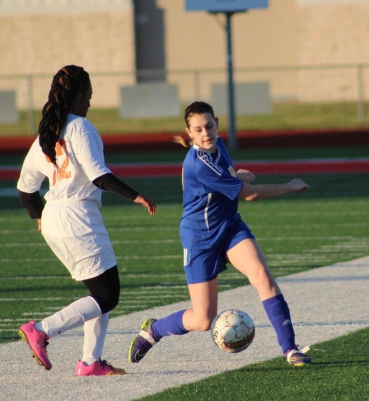 Sadi English from JV controlling the ball.