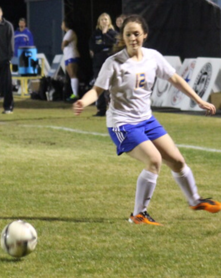 Melanie Brewer fielding the ball (photo by Madison Routon)