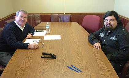 Interviewer Mike Kennedy, left, and Keenon Ashworth, right, get acquainted before beginning the interview process.