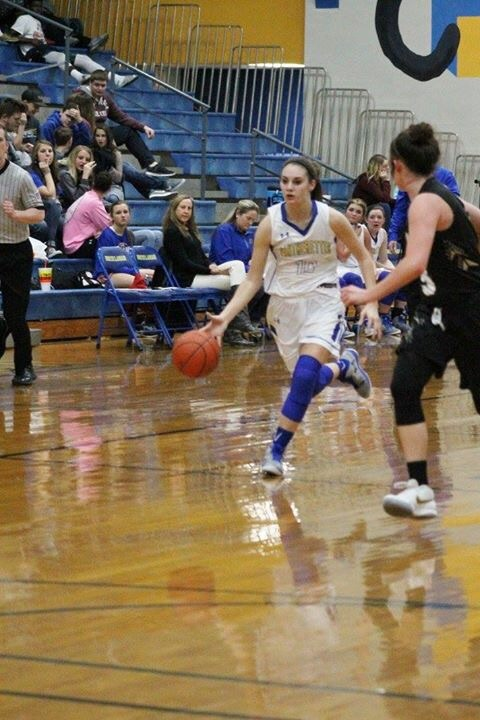 (Photo by Amber Clark) Madison Morrison driving to the lane against PG