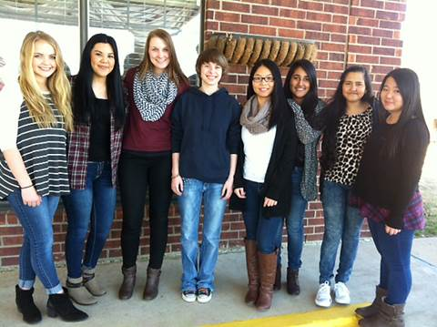 North Lamar Key Club members, beginning left, Katie Kilcrease, Laura Sandoval, Averie Campbell, Andi Willis, Yuling Xiao, Dibya Khadka, Shristi Khadka and Bingbing Xiao gather on the porch of Lamar Place after wishing the residents a Happy Valentine's Day.