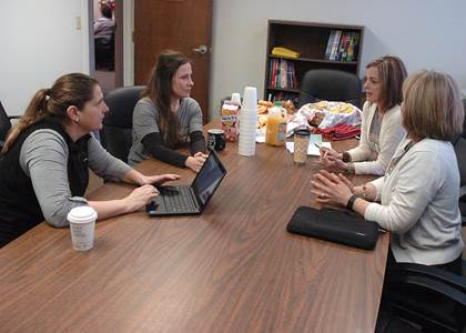 Schoolwide Enrichment Model specialist and Principal of Pleasant View School in Providence, Rhode Island, Dr. Gara Fields, left, gets feedback on Bailey's JUMP program from Counselor Keitha Chalupa, GT teacher Shelly Bivens and Principal Angela Compton.