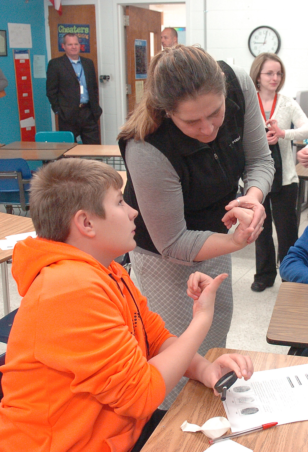 Stone sixth-grader Justin Daughtrey and Dr. Gara Fields compare thumbprints in the CSI enrichment cluster.