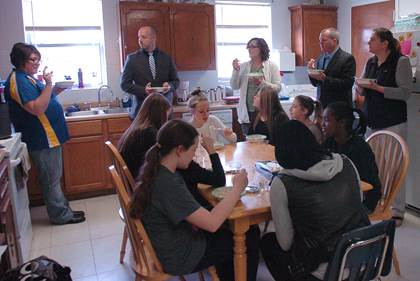 Stone's cooking class facilitated by Gina Ervin, left, and Janie Logee, third from left, made chicken and dumplings then served them to visitors Brandon Dennard, second from left, John McCullough, second from right, and Dr. Gara Fields, right.