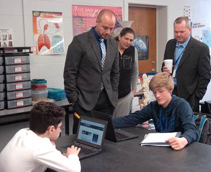 Chapel Hill Principal Brandon Dennard, Dr. Gara Fields and Superintendent John McCullough observe students as they research information on the solar system.
