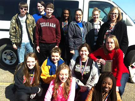NLHS UIL Academic Team members show their medals and plaques won at the Quitman UIL Academic Meet.  Beginning front row left are Sophomore Melody Shannon and Junior Rael Memnon; middle row, Junior Brittany Pilkington, Junior Jess Chollet, Sophomore Heather Armstrong and Literary Criticism Coach Dr. Linda Winfrey; back row, Sophomore Jacob Hawthorne, Junior Ty Rast, Freshman Will Rast, Junior Takeyah Griffin, Science Coach Teresa Bussell, Sophomore Kyra Conlin and Calculator Coach Carolyn Hiller.