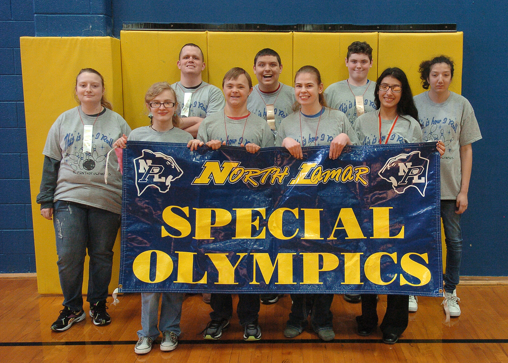 The NLHS Bowling Team displays their school banner, ribbons and medals after the state competition.