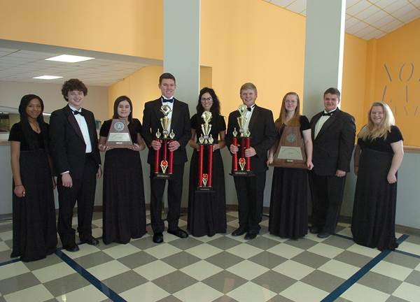 North Lamar High School senior band members display trophies won by the Symphonic and Concert Bands.  From left are Taleia Anderson, Cory Burchfield, Dani Hicks, Grant Erickson, Arilynn Hostetler, Jake Briscoe, Sydney Wilson, Alfredo Berg and Faith Vickery.