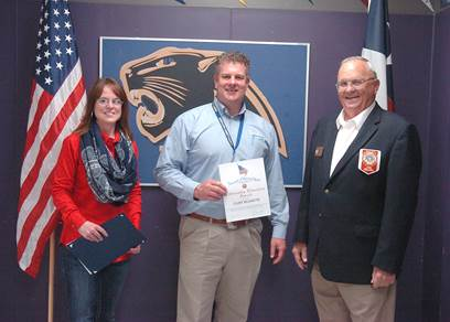 VFW Commander Bud Mackey presents English instructor Melissa Arnold for teaching citizenship and patriotism in her classes.  He then recognizes Principal Clint Hildreth for promoting citizenship at North Lamar High School.