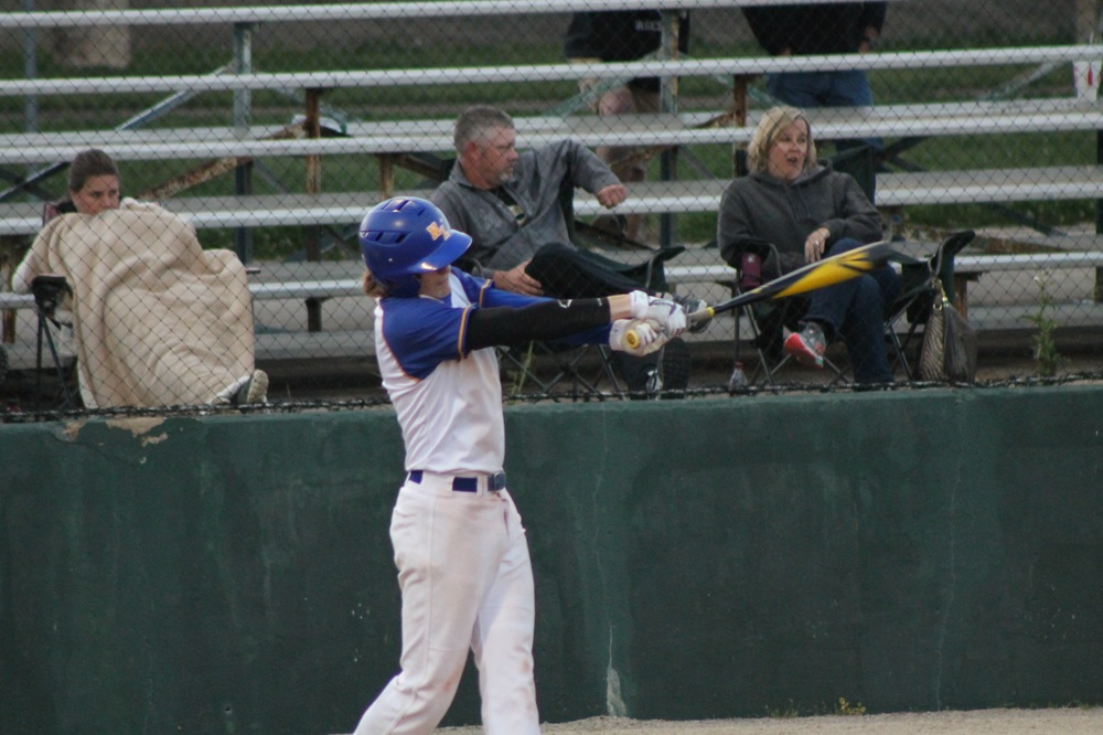 Chad Box with a hit during a game earlier this year.