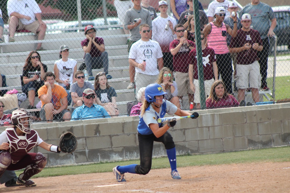 Jaycie McEwin squaring around for a bunt for North Lamar