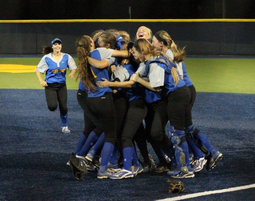 (Photo by Amber Clark) North Lamar celebrating after the final out in game 3 against Pleasant Grove.