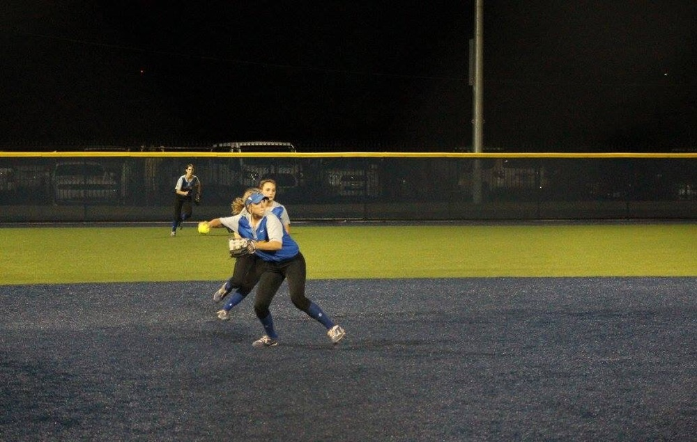 (Photo by Amber Clark) Erin Scholl with a throw to first for the final out of the series.