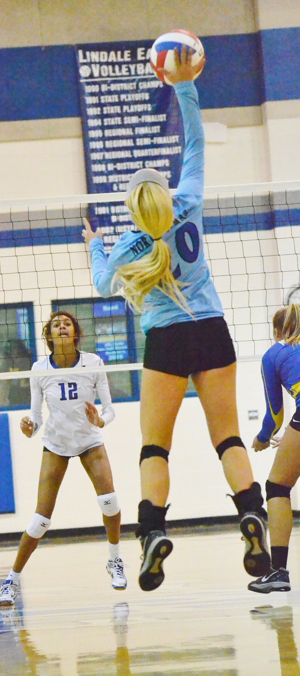 (Photo by Beverly White) Natalie Allen hitting the ball for North Lamar