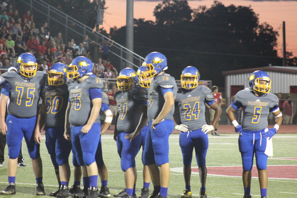 (Photo by Maddy Routon) The North Lamar offense waiting on a play from the sideline.
