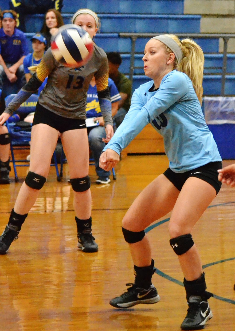 (Photo by Beverly White) Natalie Allen setting the ball for the Pantherettes against Pittsburg.