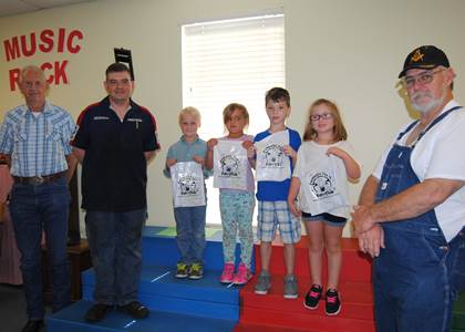 Member of the Roan Oak Masonic Lodge handed out dental packets to every first grader at Aaron Parker Elementary. Pictured from left are James Parson, Travis King, Wrylee Romans, Cenedy Renfro, Logan Dobbs, Alivia Hughes, and Mike Parson.