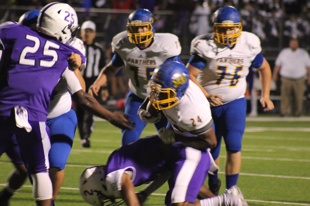 (Photo by Maddy Routon) Javon Franklin with the ball carry for North Lamar.