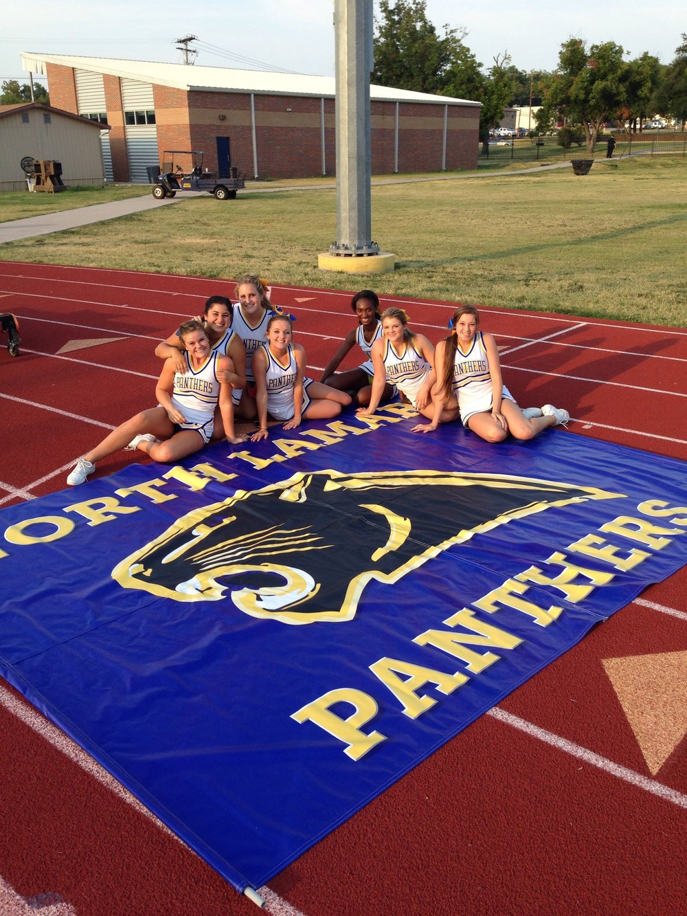Jamielynn Parker (right) and the other varisty cheerleaders displaying a new banner last year.