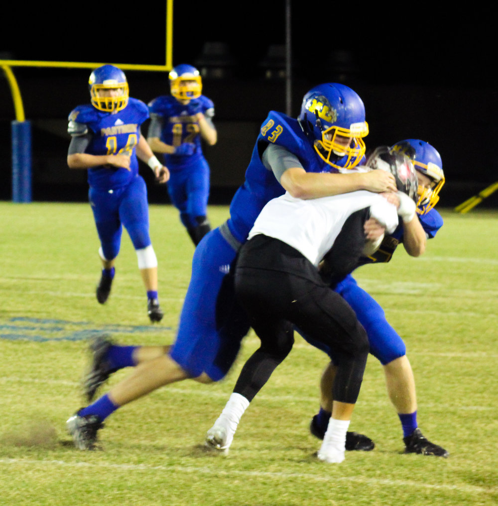(Photo by Adam Routon) Jake Stewart (83) making a tackle for North Lamar.