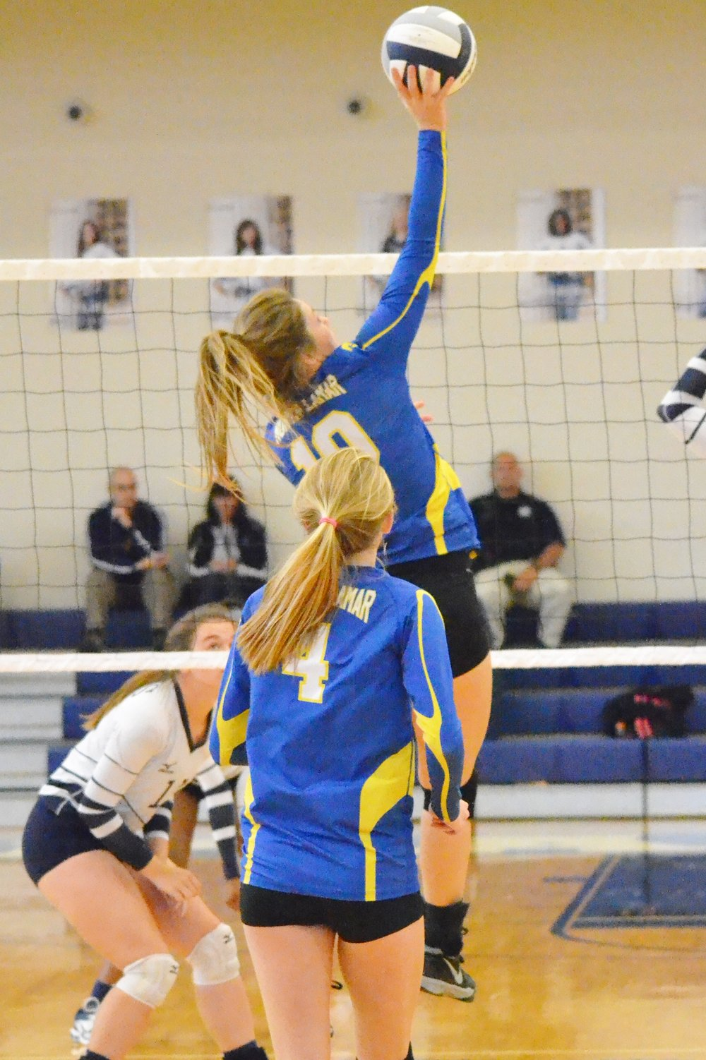 (Photo by Beverly White) Bailee Nickerson (10) hitting the ball over the net while Karlie Ewell (4) looks on.