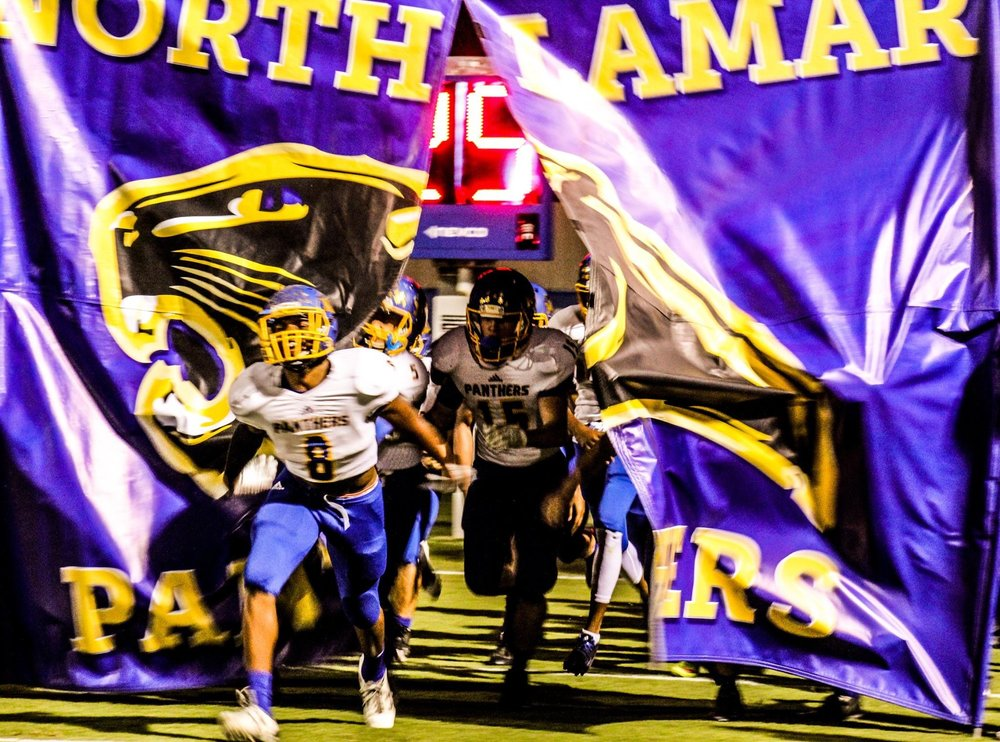 Photo by Maddy Routon: North Lamar running onto the field against Quinlan Ford