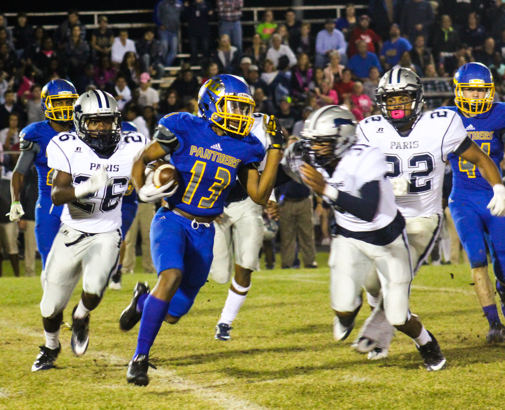 (Photo by Adam Routon) Seybian Holt (13) with a kickoff return for North Lamar