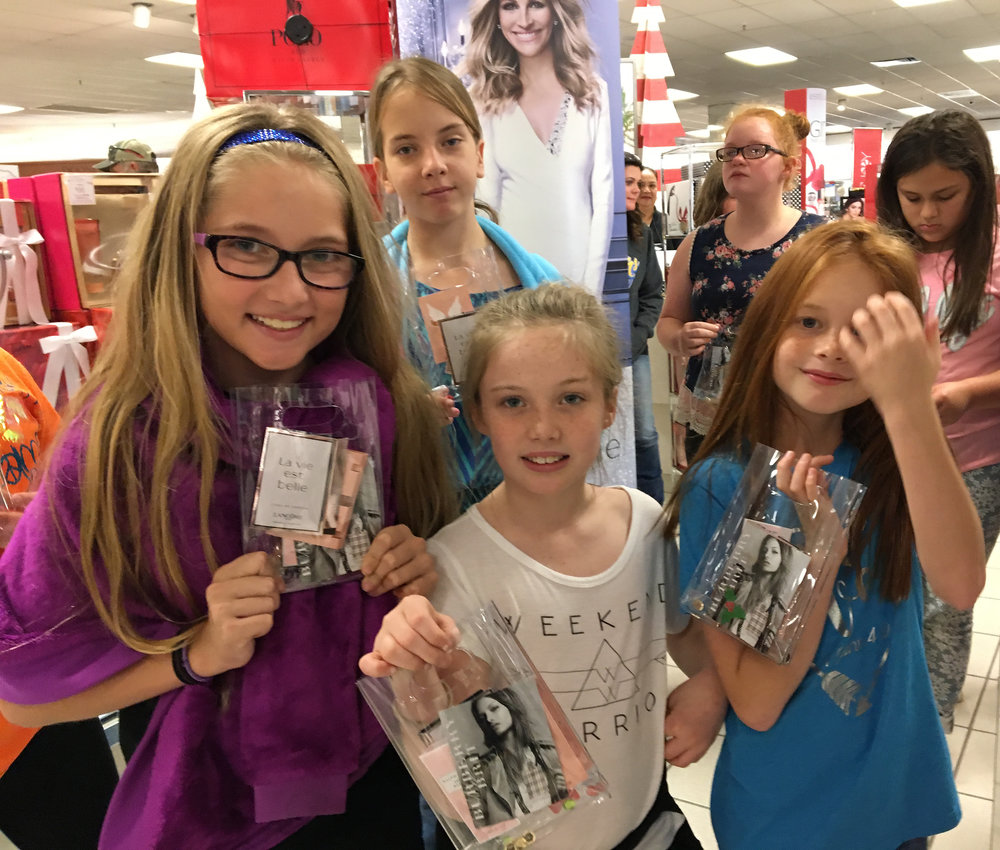Showing cosmetic and perfume samples they received while touring Belk are members of the Bailey Intermediate School's Fashionista JUMP group.  Beginning front row left are Avery Scott, Amberlee Freelen, and Nadia Bowman.  Standing in back are Alexis Roberts, Emily Maggard, and Aleiya Resendiz