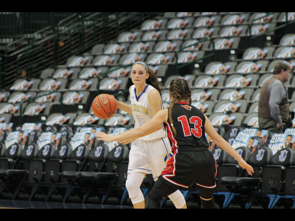 Madison Morrison dribbling the ball up the court for North Lamar