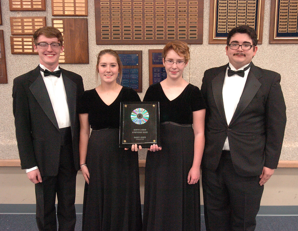 Representing the North Lamar High School Symphonic Band with the 2016 Mark of Excellence/National Wind Band Honors plaque from left are Tanner Liles, Alex Phillips, Laura Daniel, and Donivan Mullens.­­