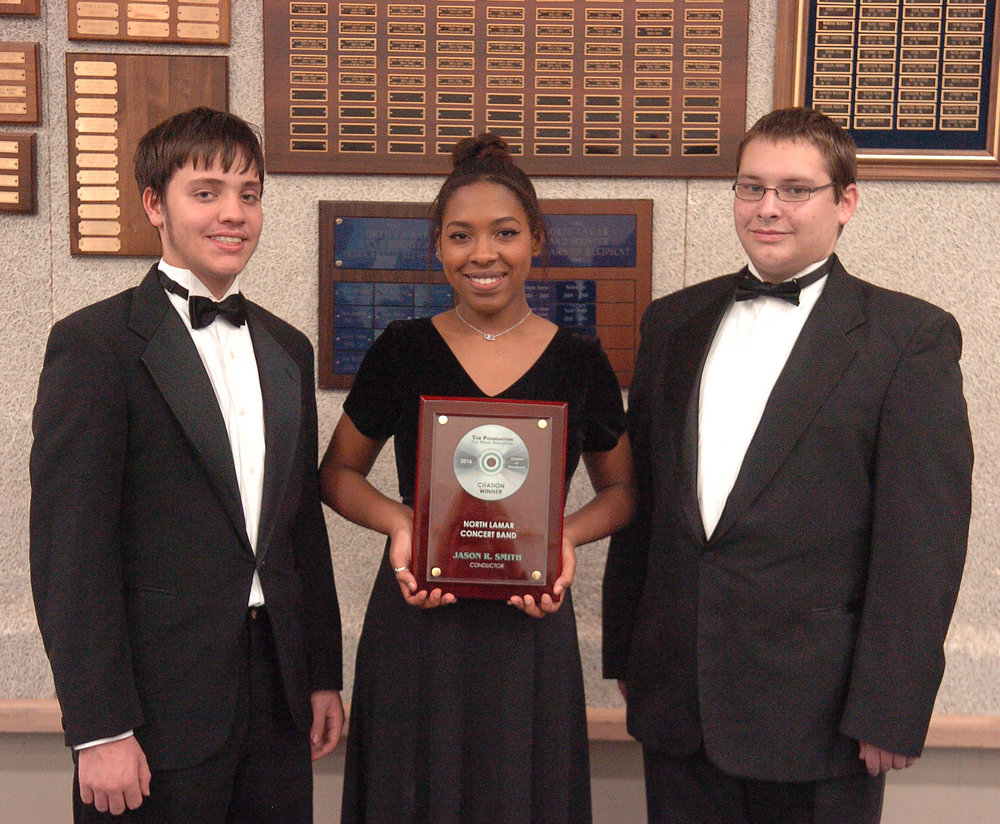 Josh Boler, Taleia Anderson, and Paul Daniel proudly display the 2016 Citation of Excellence/National Wind Band Honors plaque the North Lamar High School Concert Band received after competing against 5A and 6A bands across the nation.