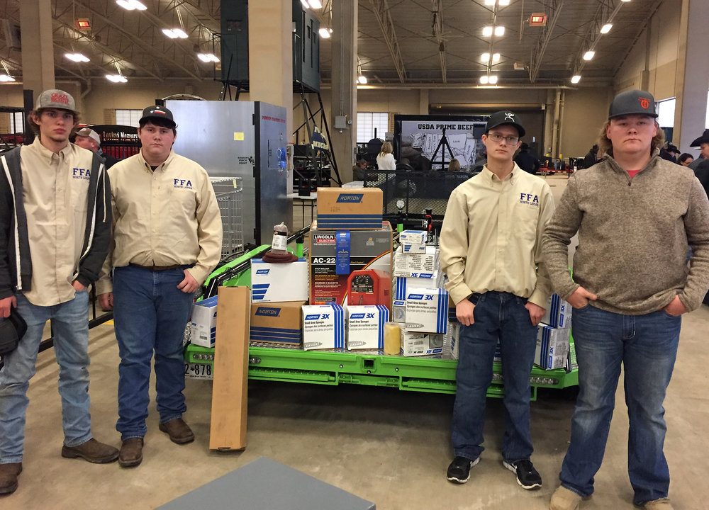 North Lamar's Ag Mechanics team placed first with their trailer at the Ft. Worth Stock Show.  From left are Jeffery Money, Jacob Hignight, Dalson Lee and Doran Hutchison.