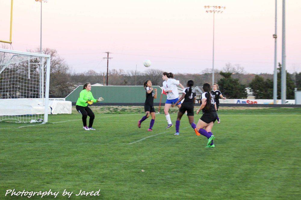 Sydney Beshirs sends a header in for a goal (photo by Jared Routon)