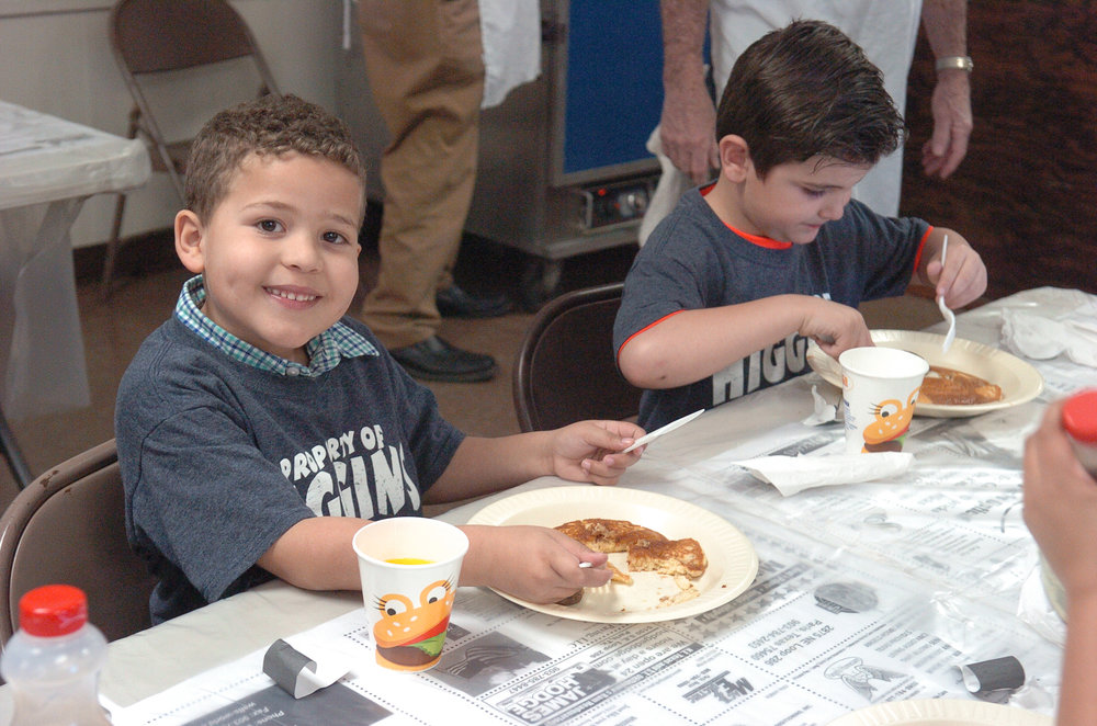 Kingstan Kain and Jaydon Garite of Tiffanie Bell's first grade class at Higgins enjoy their pancakes.