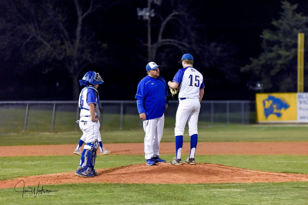 (Photo by Joe Watson) Coach Kent Craig talks to Seth Adams (15) while Nick Noble watches in a game earlier in the season.