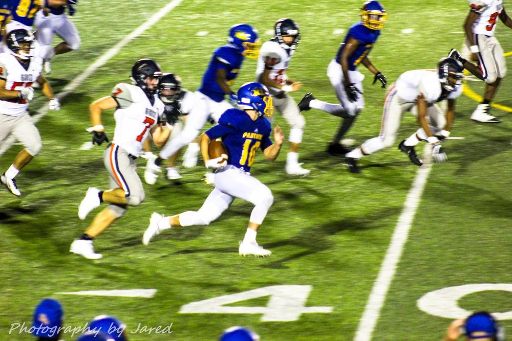 (Photo by Jared Routon) Jeremiah Guenther with a break away run against Leander Glenn. Guenther finished with 181 yards rushing for North Lamar