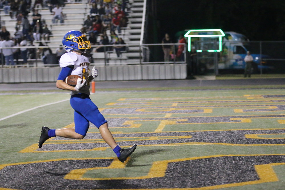 (Photo by Lynn English) Jeremiah Guenther with a touchdown run against Mt. Pleasant friday.