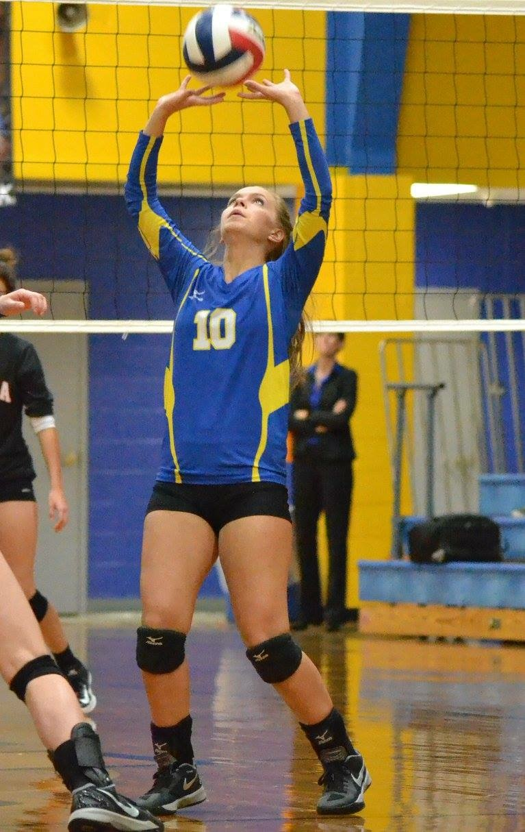 Photo by Beverly White: Madelyn Clark setting the ball for North Lamar