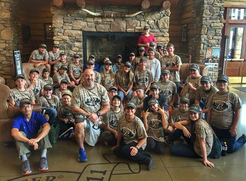 Stone Middle School's Outdoor Education class gathers at Cabela's for a picture to be included on the chains Facebook page.
