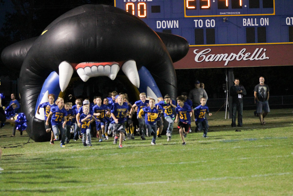 (Photo by Lynn English) Junior Panthers run on the field in Youth Night