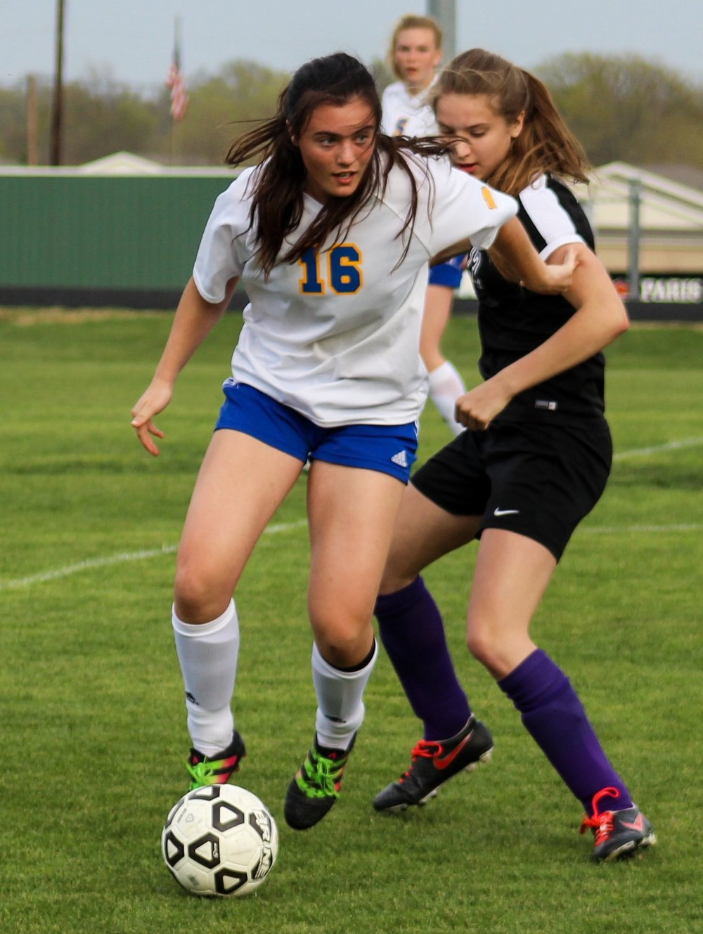 Abbie Fischer fights for control of the ball