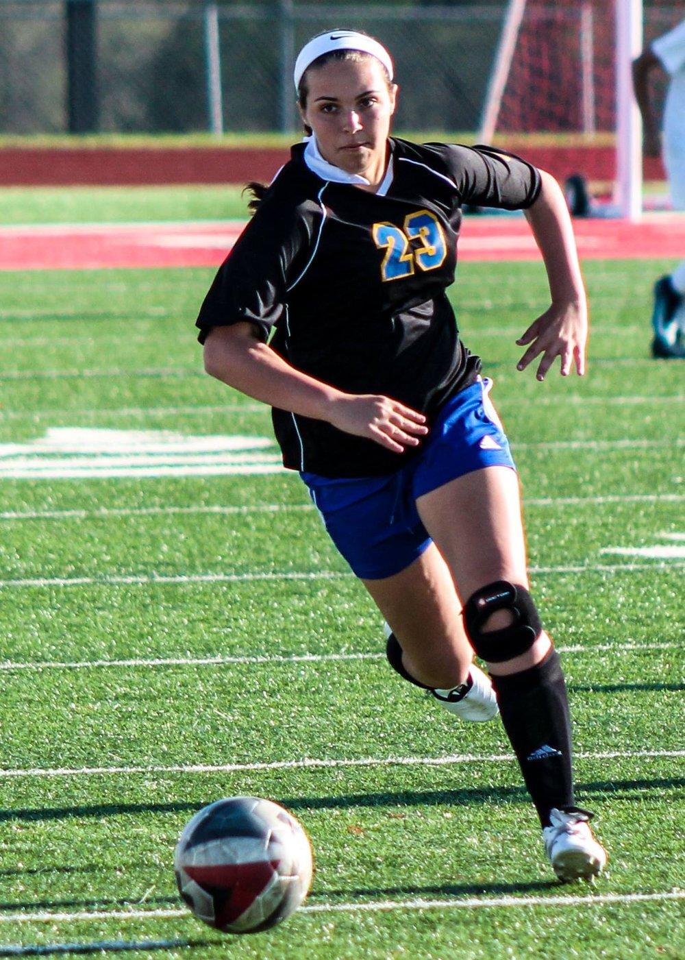 Adrianna Evans runs down the ball